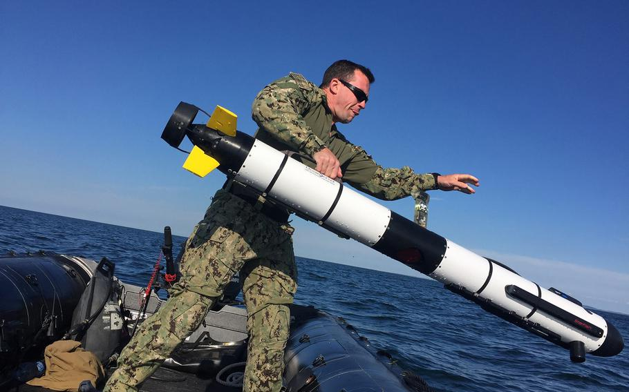 A member of Platoon 802, a mine countermeasures platoon assigned to Explosive Ordnance Disposal Mobile Unit  8, conducts mine countermeasures search operations in the western Baltic Sea as part of exercise BALTOPS 17 in Todendorf, Germany, June 6, 2017.