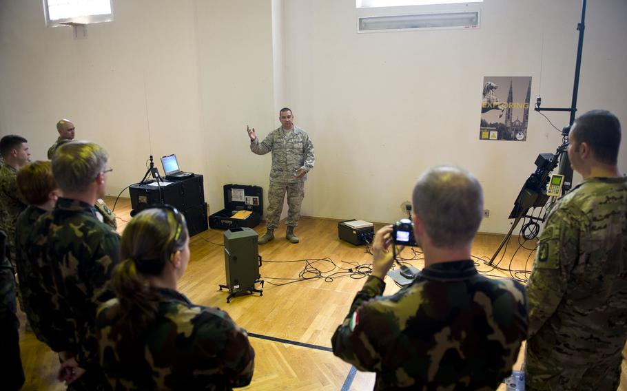 U.S. Air Force Tech. Sgt. Christopher Hardy, from the 7th Weather Squadron, describes the radio transmitting capabilities of a Tactical Meteorological Observing System during Exercise Cadre Focus 17-1 at McCully Barracks, Germany, on Wednesday, June 14, 2017.