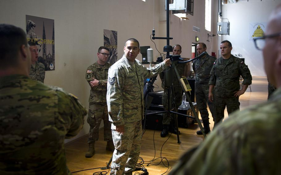 Tech. Sgt. Christopher Hardy, from the 7th Weather Squadron, describes how to configure a Tactical Meteorological Observing System radio transmitter during Exercise Cadre Focus 17-1 at McCully Barracks, Germany, on Wednesday, June 14, 2017.