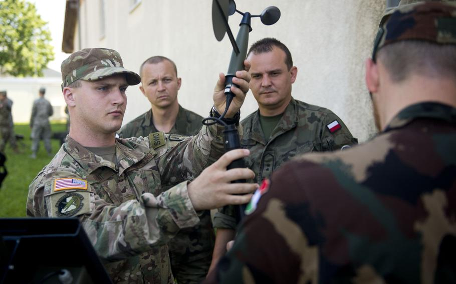 Airman 1st Class Athon Arant demonstrates how to assemble a Tactical Meteorological Observing System for Polish and Hungarian weather troops during Exercise Cadre Focus 17-1 at McCully Barracks, Germany, on Wednesday, June 14, 2017.