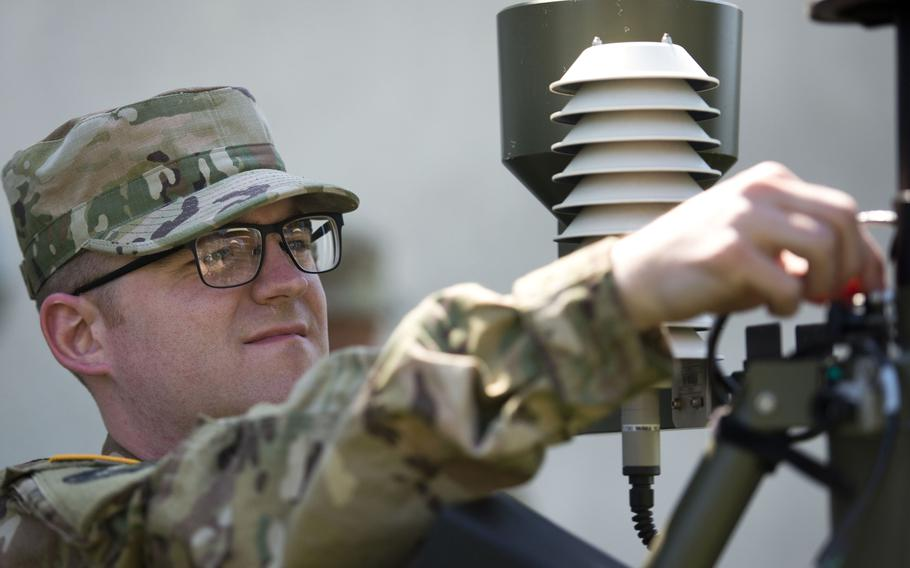 Airman 1st Class Andrew Boos assembles a Tactical Meteorological Observing System during a timed certification test at McCully Barracks, Germany, on Wednesday, June 14, 2017.