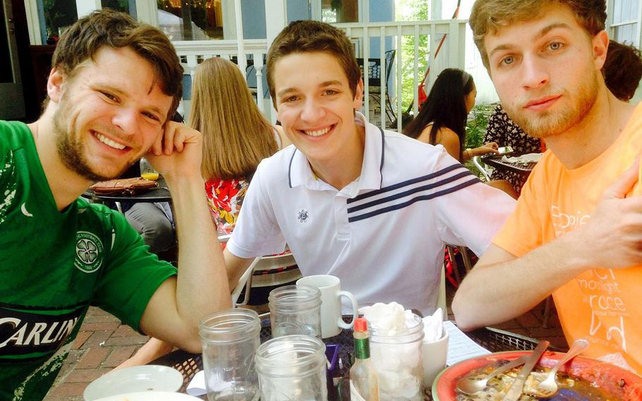 Otto Warmbier, left, with friends Emmett Saulnier, center, and Ned Ende in May 2015.