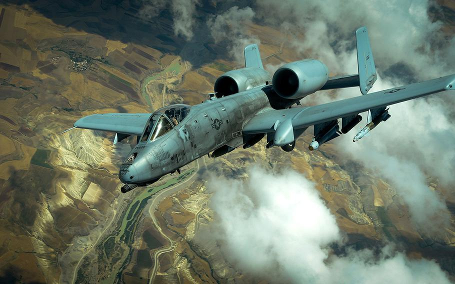 A U.S. Air Force A-10 Thunderbolt II departs after receiving fuel from a 908th Expeditionary Air Refueling Squadron KC-10 Extender during a flight in support of Operation Inherent Resolve May 31, 2017.