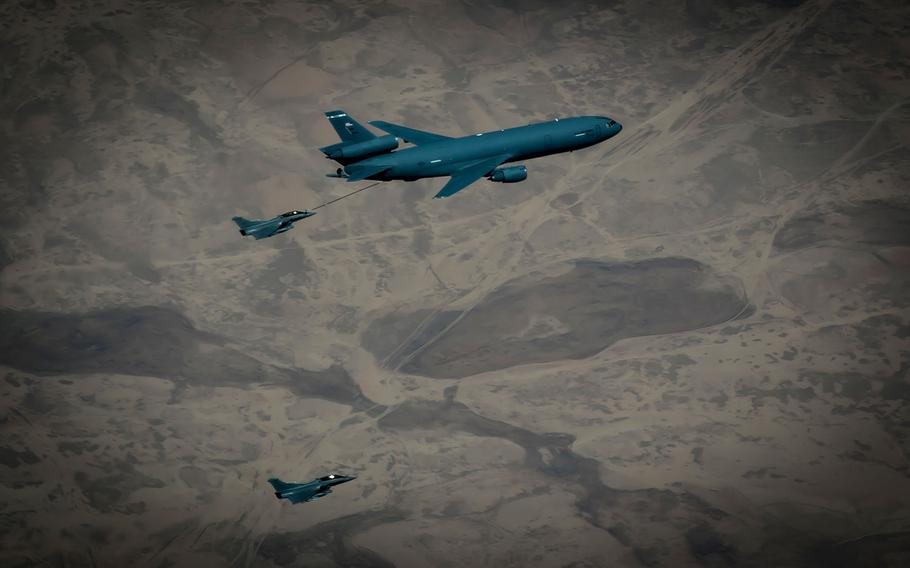 Two French fighter jets receive fuel from a KC-10 Extender during a flight in support of Operation Inherent Resolve May 9, 2017.