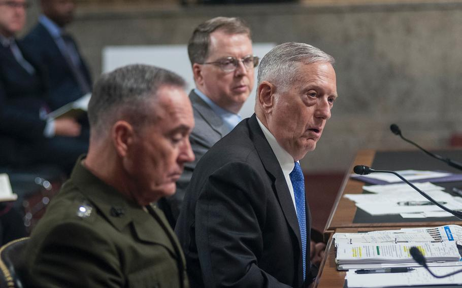 Defense Secretary Jim Mattis, center, testifies before the Senate Armed Services Committee on June 13, 2017, during a hearing on Capitol Hill in Washington, D.C. At left is Chairman of the Joint Chiefs of Staff General Joseph Dunford.