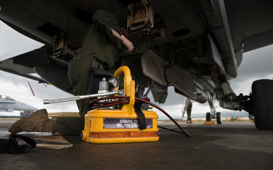 A fixed wing aircraft mechanic assigned to Marine Fighter Attack Squadron 251 conducts maintenance on an F/A-18C Hornet during Red Flag-Alaska 17-2 on Joint Base Elmendorf-Richardson, Alaska, June 14, 2017.