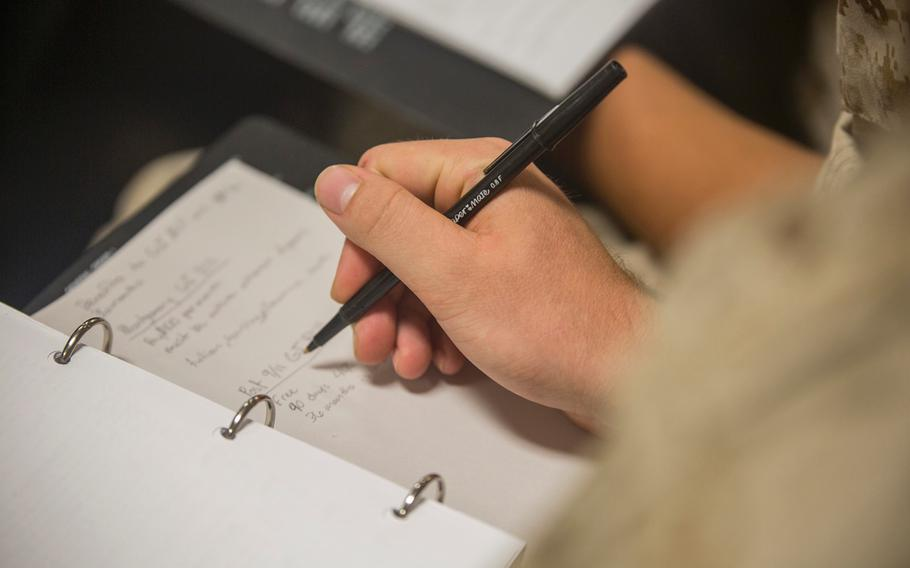 A recruit with Delta Company, 1st Recruit Training Battalion, takes notes during a class for educational benefits Aug. 26, 2015, on Parris Island, S.C.