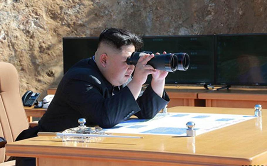 North Korean leader Kim Jong Un watches what North Korea claims was its first successful test of an intercontinental ballistic missile on July 4, 2017.