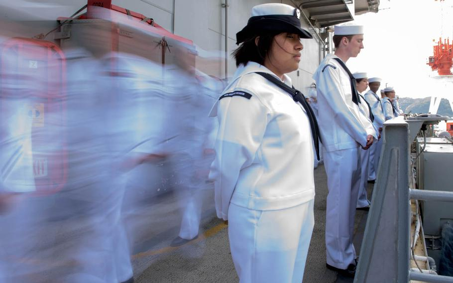 Sailors man the rails aboard the aircraft carrier USS Ronald Reagan as the ship begins its 2017 patrol in May from Yokosuka, Japan.