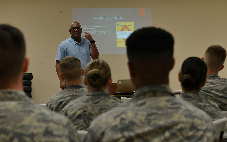 Karl Johnson, 20th Security Forces Squadron trainer, demonstrates answering the phone at Shaw Air Force Base, S.C., Jan. 18, 2017.  He explained proper operational security techniques for speaking on the telephone during an OPSEC brief.