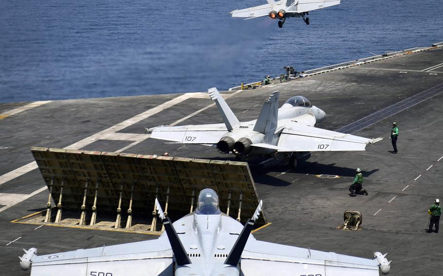 A Super Hornet  launches from the flight deck of the aircraft carrier USS Nimitz in the Arabian Gulf, Saturday, July 29, 2017.
