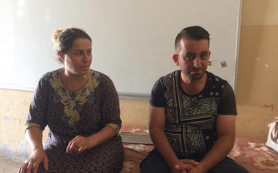 Yazidi couple Hazna Hassan, 35, left, and Firas Alyas, 40, talk about living in a camp for displaced people in Irbil, Iraq, for three years. They are preparing to return home following the liberation of their town from the Islamic State.