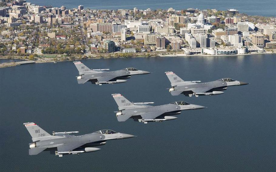 Four F-16C Fighting Falcons from the Wisconsin Air National Guard fly over the capital city of Madison, Wis., in 2008.