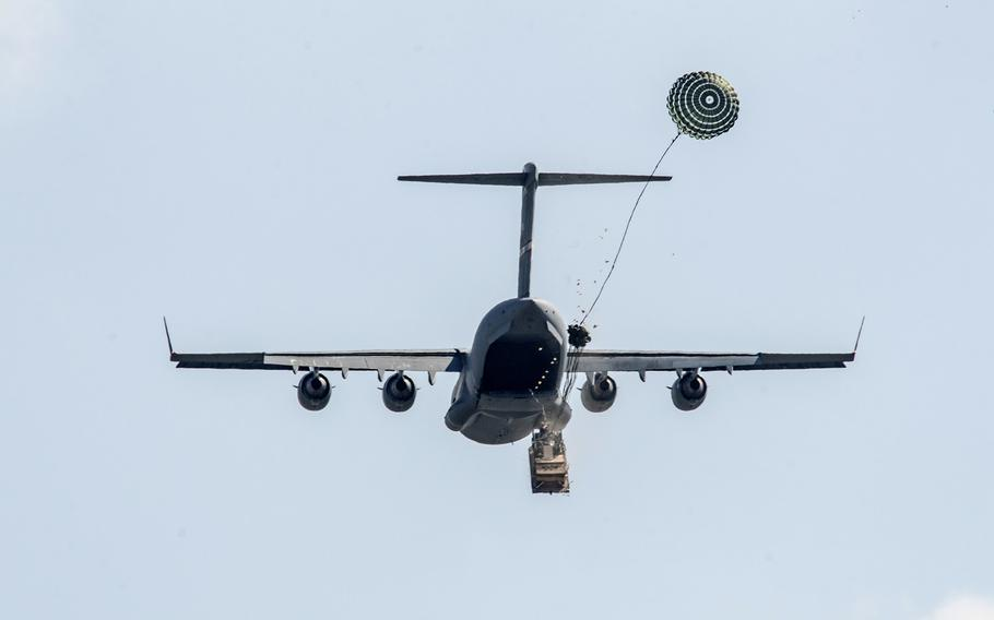 Soldiers of the 173rd Airborne Brigade release a heavy drop from a Boeing C-17 Globemaster III while conducting an airborne operation during exercise Saber Junction on April 11, 2016, at Joint Multinational Readiness Center in Hohenfels, Germany.