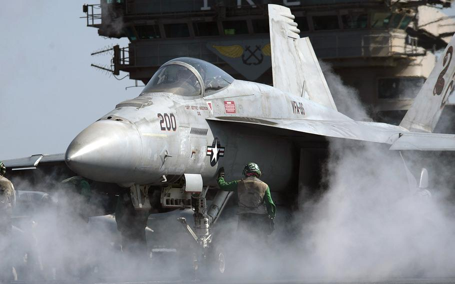 In an October, 2016 file photo, an F/A-18E Super Hornet undergoes preflight checks prior to launching from the flight deck of the aircraft carrier USS Dwight D. Eisenhower in the Persian Gulf.