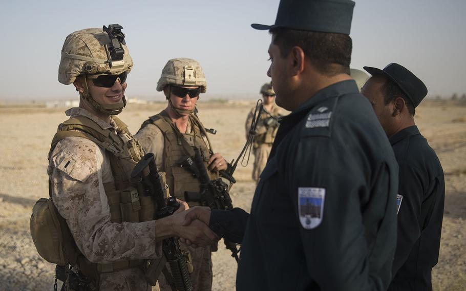 A U.S. Marine advisor with Task Force Southwest thanks an Afghan National Policemen for showing them around and introducing them to the ANP security guards at Bost Airfield, Afghanistan, July 31, 2017.