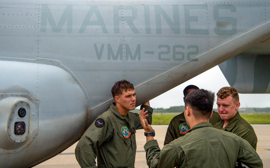 Marines assigned to the Marine Medium Tiltrotor Squadron 262 in Okinawa, Japan, discuss flight operations at Misawa Air Base, Japan, July 31, 2017. The squadron was preparing for upcoming Northern Viper drills.