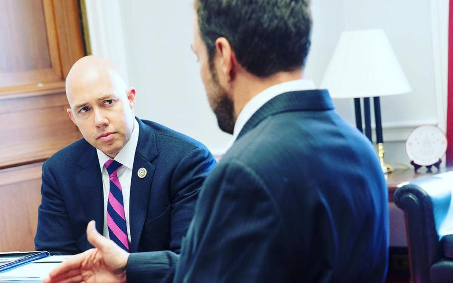Rep. Brian Mast, R-Fla., speaks with a representative of the Paralyzed Veterans of America on March 8, 2017. Mast, a wounded Army vet, is championing an idea that would ask servicemembers leaving active duty to sign an oath not to harm themselves.