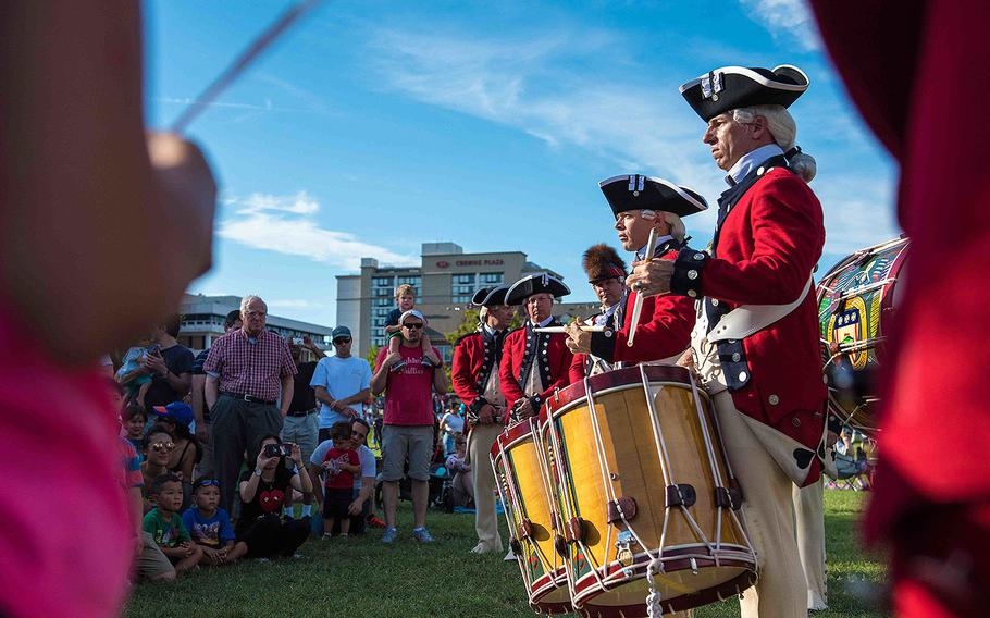 Soldiers with the U.S. Army Old Guard Fife and Drum Corps, assigned to the 3d U.S. Infantry Regiment (The Old Guard), participate in Alexandria City Birthday Celebration at Oronoco Bay Park, Alexandria, Va., July 8, 2017.