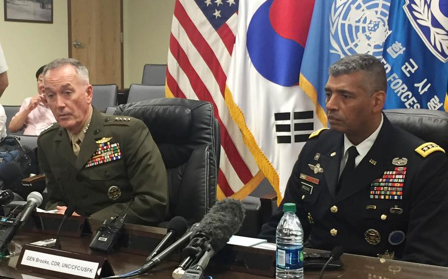 Gen. Joseph Dunford, left, chairman of the Joint Chiefs of Staff, and Gen. Vincent Brooks, commander of U.S. Forces Korea, speak at a press conference, Monday, Aug. 14, 2017, in Seoul, South Korea.