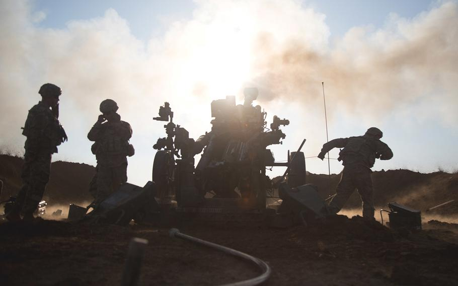 U.S. soldiers assigned to Battery C, 2nd Battalion, 319th Airborne Field Artillery Regiment, 82nd Airborne Division fire their M777 towed 155 mm howitzer during a fire mission near Mosul, Iraq, Feb. 03, 2017.