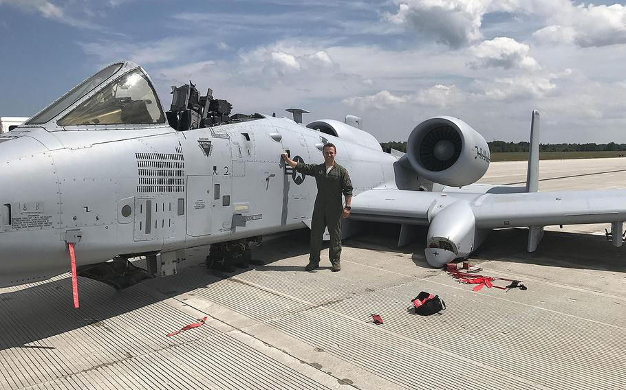 Capt. Brett DeVries, an A-10 Thunderbolt II pilot of the 107th Fighter Squadron from Selfridge Air National Guard Base, poses next to the aircraft he safely landed after a malfunction forced him to make an emergency landing July 20, 2017 at the Alpena Combat Readiness Training Center.