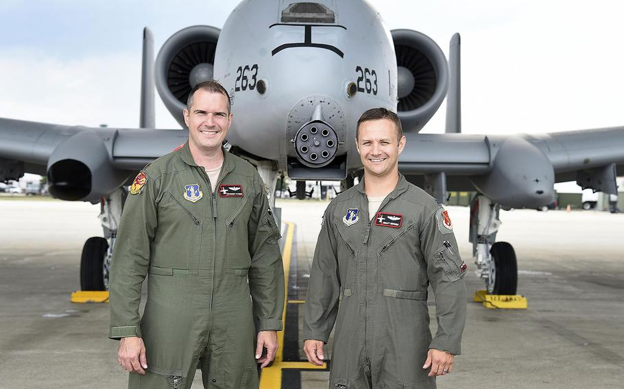 Capt. Brett DeVries (right) and his wingman Maj. Shannon Vickers, both A-10 Thunderbolt II pilots of the 107th Fighter Squadron from Selfridge Air National Guard Base, Mich. Vickers helped DeVries safely make an emergency landing July 20, 2017.