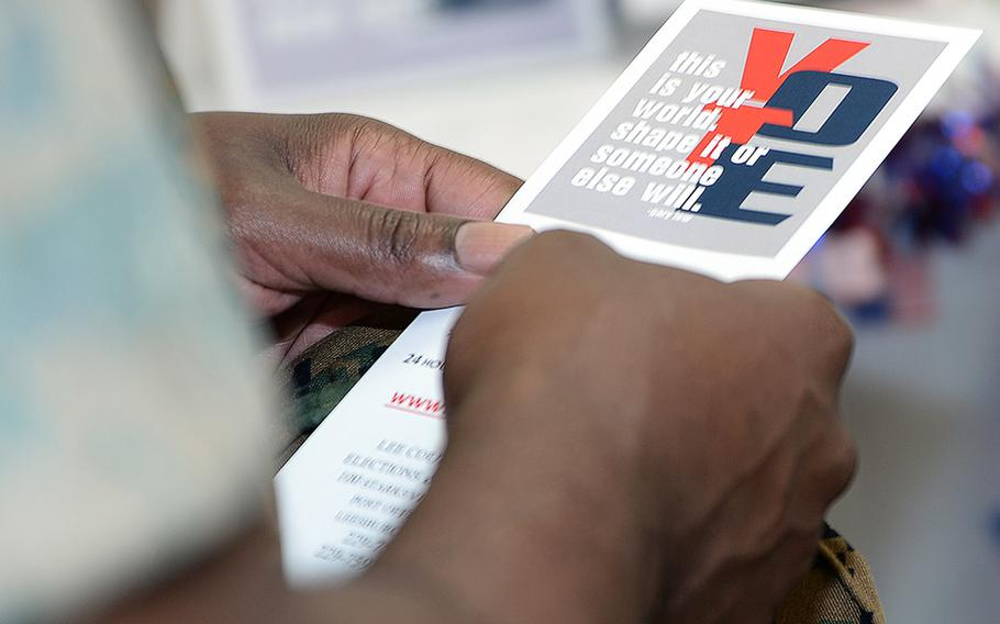 A Marine voter reads voting literature during the Marine Corps Logistics Base Albany's first voting convention, June 22, 2017.