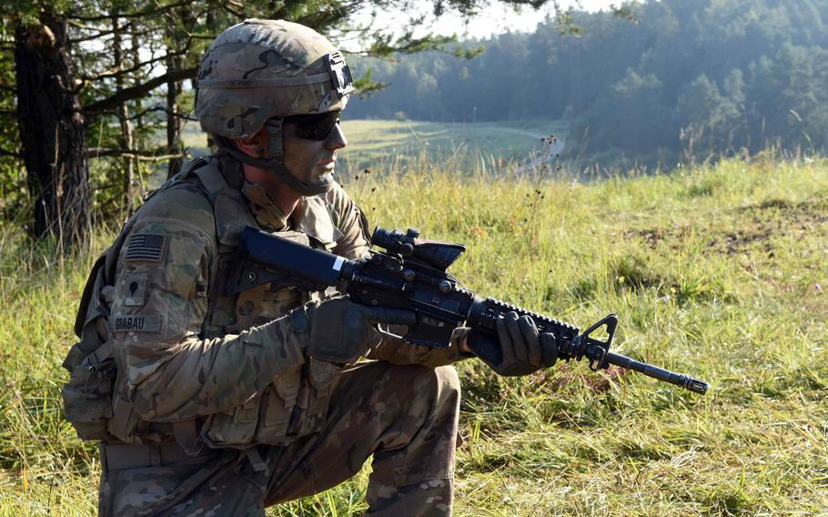 Spc. Mathias Grabau, a Humvee driver with the Army's 3rd Armored Brigade Combat Team, provides security during Exercise Combined Resolve 9 at Grafenwoehr, Germany, on Aug. 23, 2017.