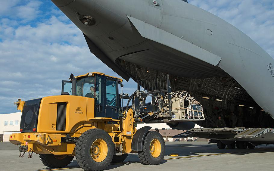 Alaska Air National Guard airmen load and secure cargo onto a Joint Base Elmendorf-Richardson C-17 Globemaster III in Alaska on Aug. 28, 2017. They were traveling to Houston as part of a humanitarian mission in response to Hurricane Harvey.