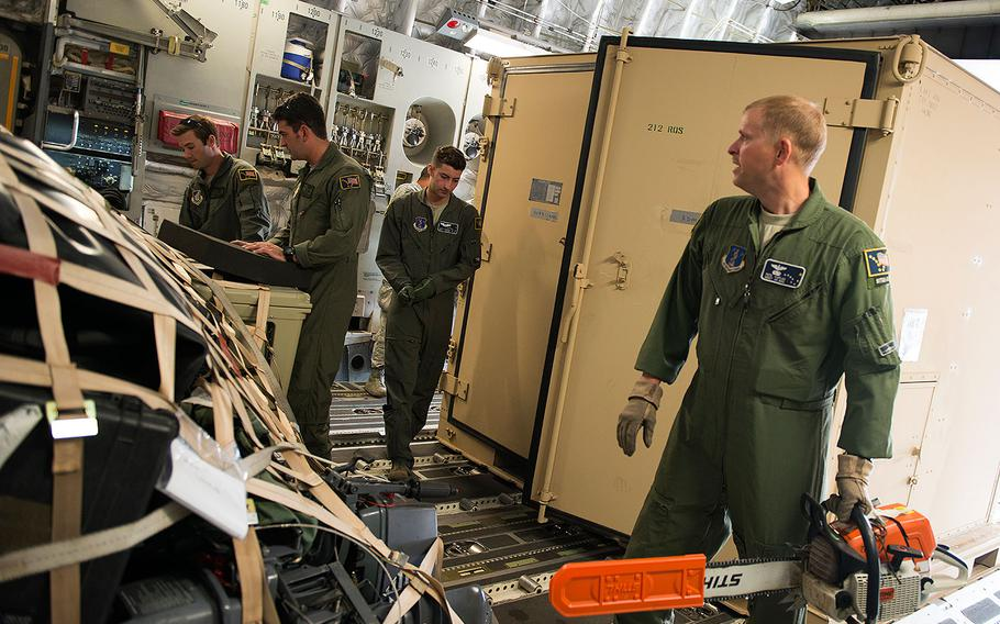 Alaska Air National Guard airmen load and secure cargo on a C-17 Globemaster III at Joint Base Elmendorf-Richardson on Aug. 28, 2017 before traveling to Houston in response to Hurricane Harvey.