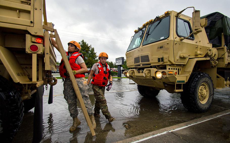 Soldiers with the Texas Army National Guard ready their trucks as they make their way through Houston while floodwaters from Hurricane Harvey continue to rise, Monday, Aug. 28, 2017.