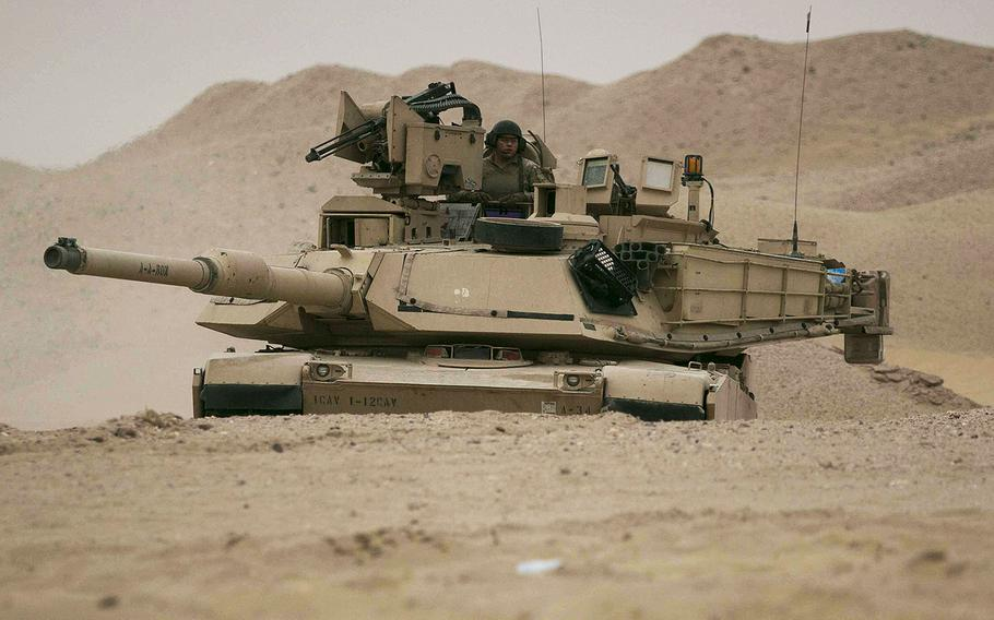 An M1A2 Abrams Main Battle Tank assigned to Alpha Company, 1st Battalion, 12th Cavalry Regiment, 3rd Armored Brigade Combat Team, 1st Cavalry Division maneuvers to the final objective during the company's situational training exercise in Kuwait, July 15, 2017.