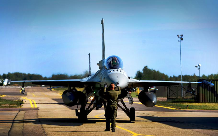 A Polish F-16 pilot taxis after completion of a Baltic Air Policing sortie at Siauliai Air Base, Lithuania, on Wednesday, Aug. 30, 2017.