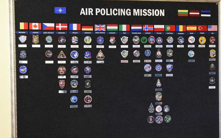 A bulletin board at Siauliai Air Base, Lithuania displays squadron patches from the nations participating in the Baltic air policing mission since it began in the spring of 2004.