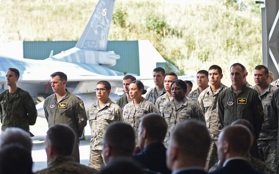 Airmen from the 493rd Fighter Squadron at Royal Air Force Lakenheath, England, stand during a ceremony on Wednesday, Aug. 30, 2017, at Siauliai Air Base, Lithuania. The ceremony marked the transfer of the control of the Baltic air policing mission from the Polish to the U.S. Air Force.
