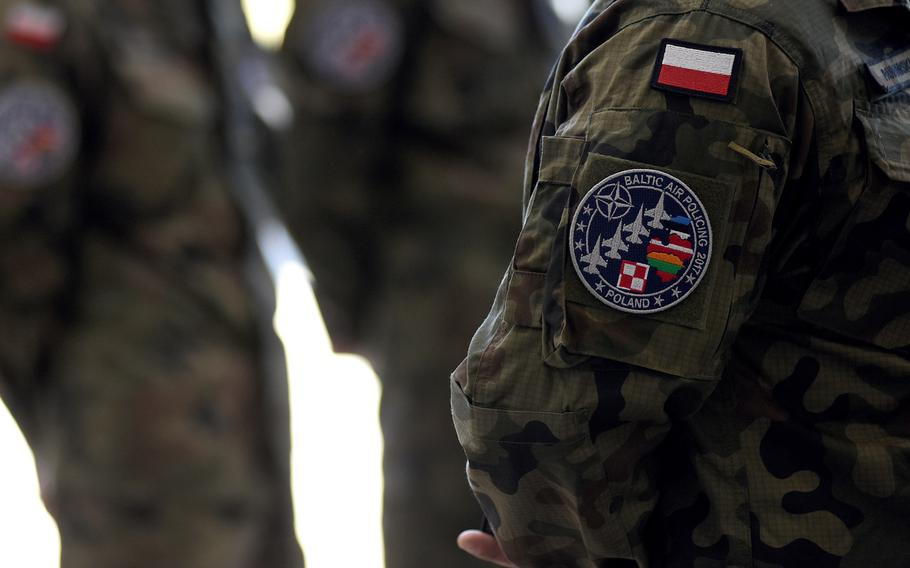 Members of the Polish air force earned a patch to war on their uniform, signifying their participation in the Baltic air policing mission this summer.