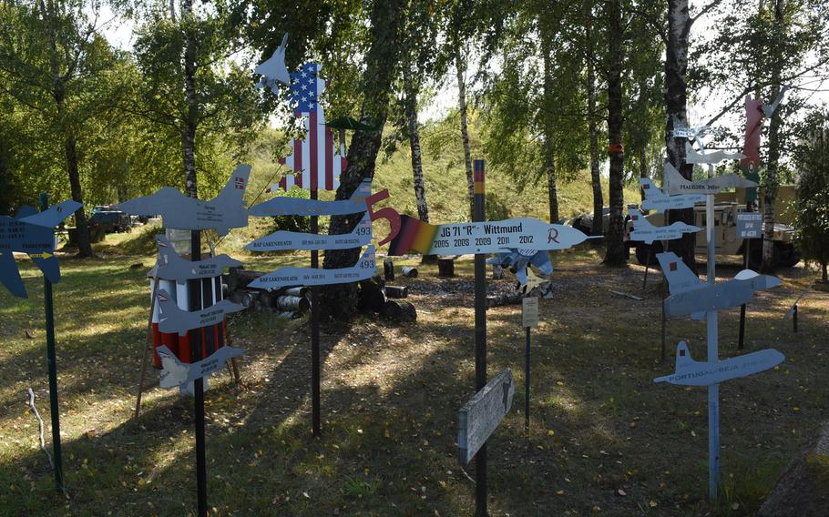 Squadrons of nations participating in the Baltic air policing mission display their part in the campaign with miniature aircraft signage at Siauliai Air Base, Lithuania.