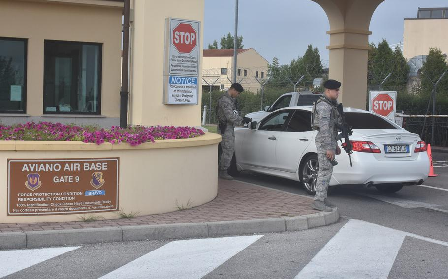 Security personnel check identifications as cars pull into the main gate at Aviano Air Base, Italy, on Aug. 31, 2017. A 25-year-old Moroccan national remains under house arrest after trying to get onto Aviano Air Base in early July by using an ID card bearing the name of an active-duty servicemember.