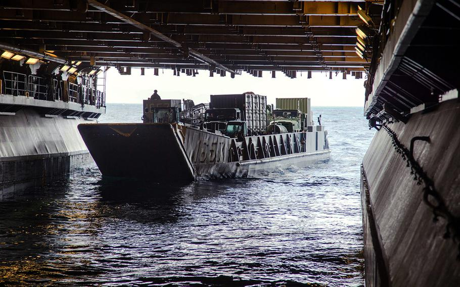 U.S. Navy Landing Craft, Utility 1657 exits the well deck of the USS Kearsarge carrying Marine Corps personnel and equipment in support of Hurricane Maria relief operations in the Caribbean Sea, Sept. 24, 2017.