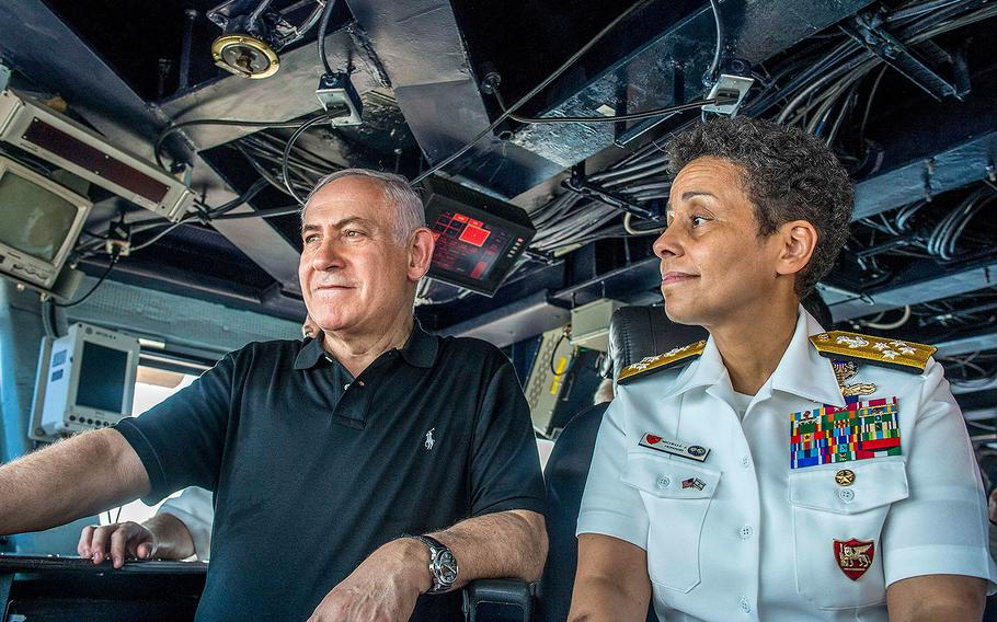 Israeli Prime Minister Benjamin Netanyahu, left, speaks with Commander, Naval Forces Europe, Adm. Michelle Howard about U.S. military operations on the bridge of the aircraft carrier USS George H.W. Bush during a visit to the ship in Haifa, Israel on July 3, 2017.