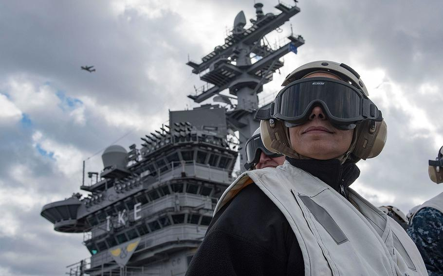 Commander, U.S. Naval Forces Europe-Africa, Adm. Michelle Howard, observes operations on the flight deck of the aircraft carrier USS Dwight D. Eisenhower in the Mediterranean Sea on Dec. 21, 2016.