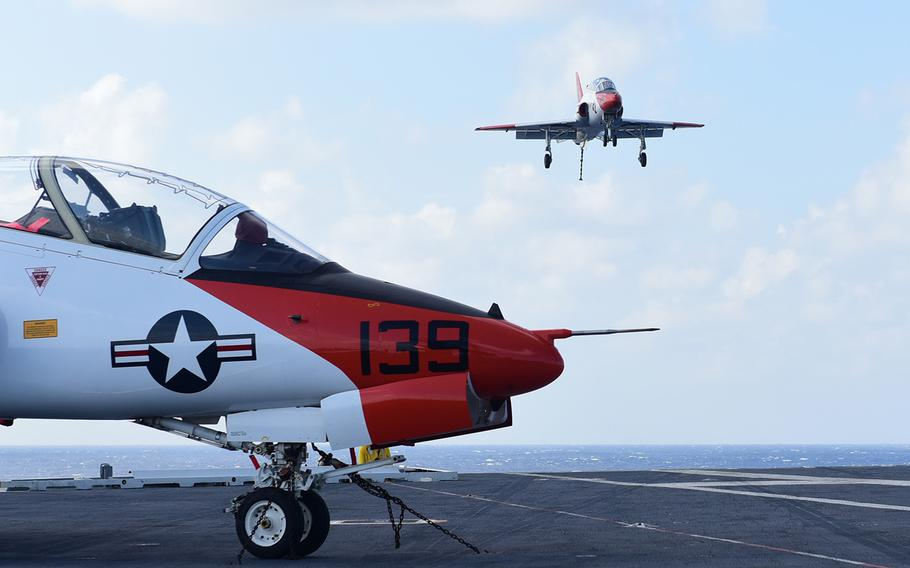 A T-45C Goshawk, assigned to Training Air Wing (TRAWING) 2, prepares land on the flight deck aboard USS Harry S. Truman on Sept. 17, 2017.