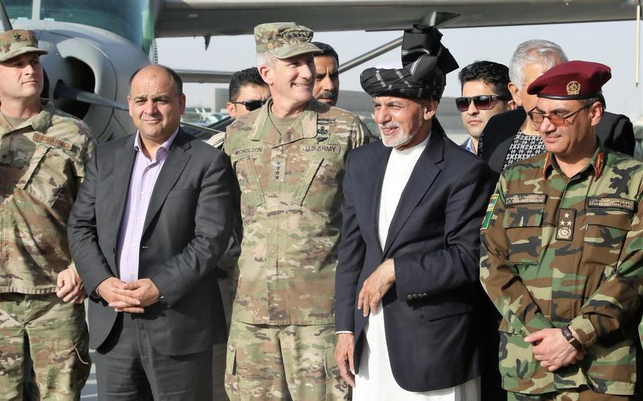 Gen. John Nicholson, commanding general of Resolute Support Mission, stands next to Afghan President Ashraf Ghani, center right, during a ceremony in Kandahar on Saturday, Oct. 7, 2017, as the United States presented two Black Hawk helicopters to the Afghan military.
