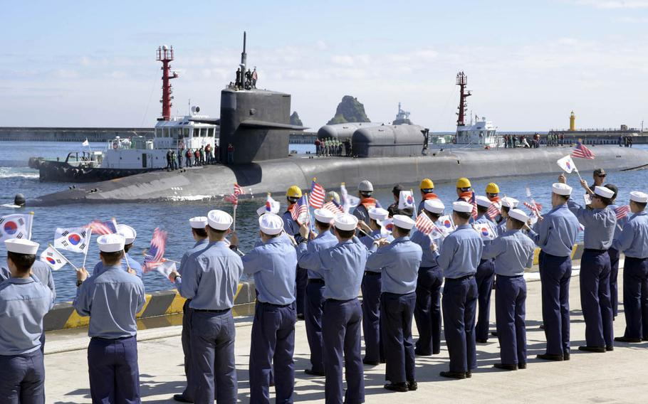 The Ohio-class guided-missile submarine USS Michigan pulls into Busan, South Korea, Friday, Oct. 13, 2017.