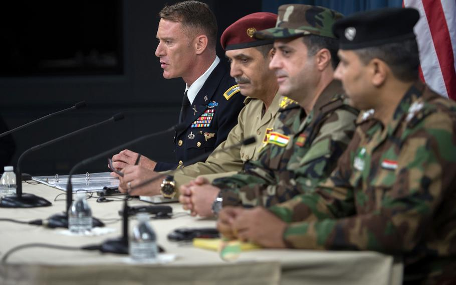 Operation Inherent Resolve spokesman Army Col. Ryan Dillon, left, and spokesmen for the Iraqi security forces brief members of the media on the Liberation of Mosul at the Pentagon, July 13, 2017. On Tuesday, Oct. 17, Dillon noted that clashes on Monday between Iraq's Kurdish forces and government-controlled Iraqi forces distract from the mission to defeat Islamic State.