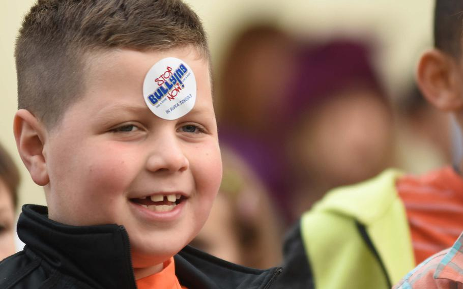 """Ryan Daniels, a student at Ramstein Intermediate School in Germany, prominently wears his """"Stop Bullying Now"""" sticker during the school's celebration of Unity Day on Wednesday, Oct. 18, 2017. The school encouraged kids to stand up to bullying while promoting kindness, acceptance and inclusion."""