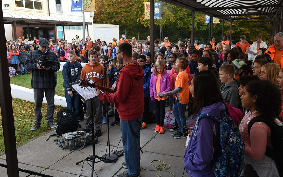 """Students at Ramstein Intermediate School in Germany joined music teacher Steven Rayburn in singing """"Don't Laugh at Me,"""" on Wednesday, Oct. 18, 2017, during the school's celebration of Unity Day. In the song, children who have been teased, among others, ask for acceptance from others."""