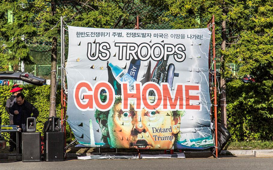 Not all South Koreans were welcoming to USS Ronald Reagan strike group sailors who arrived in Busan, South Korea, Saturday, Oct. 21, 2017.
