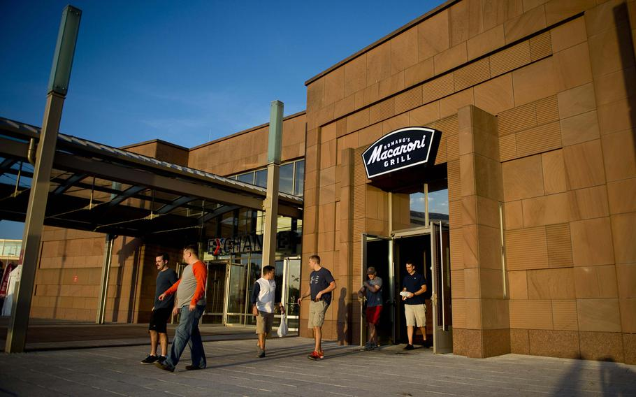 Customers leave the Romano's Macaroni Grill at Ramstein Air Base, Germany, on Thursday, Oct. 19, 2017. The restaurant will remain open despite the bankruptcy filing of its parent company.  Michael B. Keller/Stars and Stripes